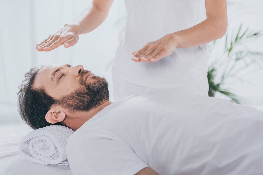 Image of a man receiving reiki treatment